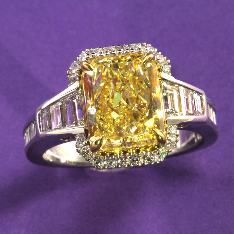 Fancy yellow rectangle modified brilliant cut diamond ring