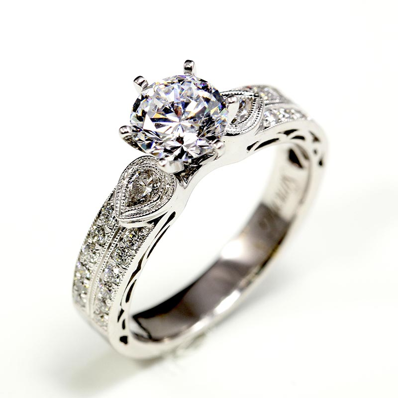 Ring with Pear-Shaped Side Stones