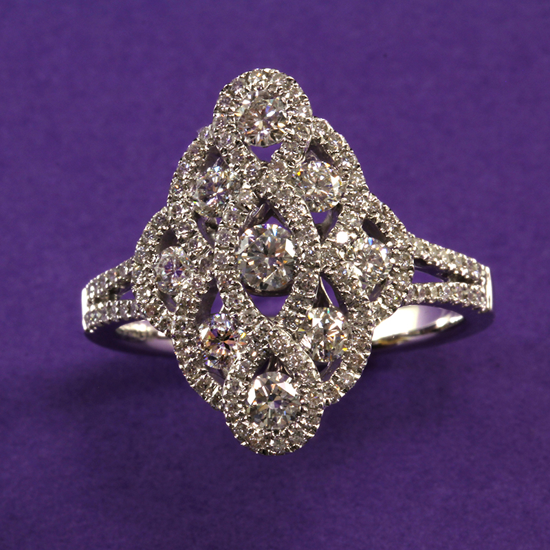 Round Diamonds Fashioned in Marquise shape ring